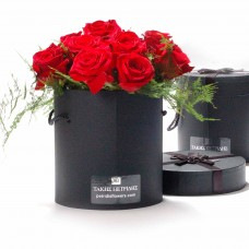 Roses bouquet in a black box