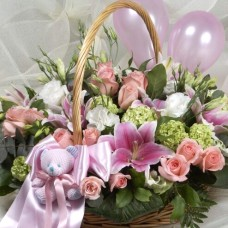 Basket with flowers and teddy bear for baby girls