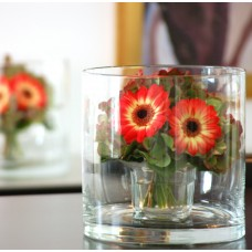 Hydrangeas and gerberas in round glass vase