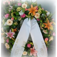 Sympathy wreath with roses, gerberas and lilies