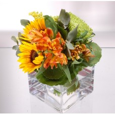 Sunflowers and alstromerias in glass vase