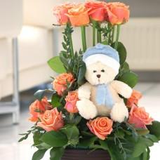 Roses andteddy bear arrangement