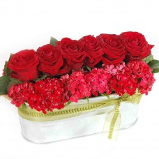Red roses in metal tray