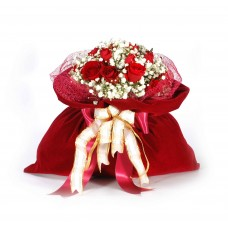 Red roses in velvet pouch